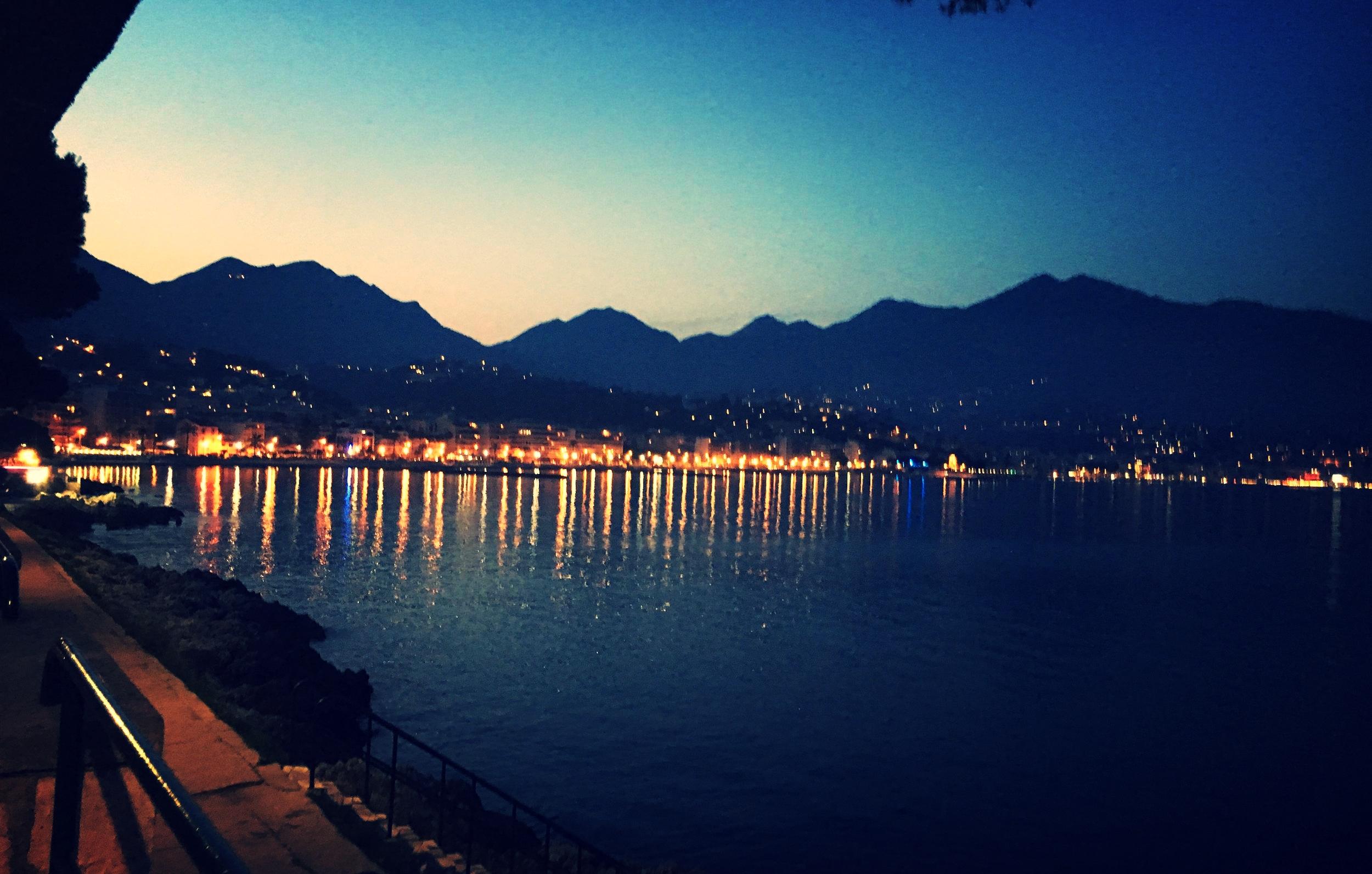 bay of menton france at night