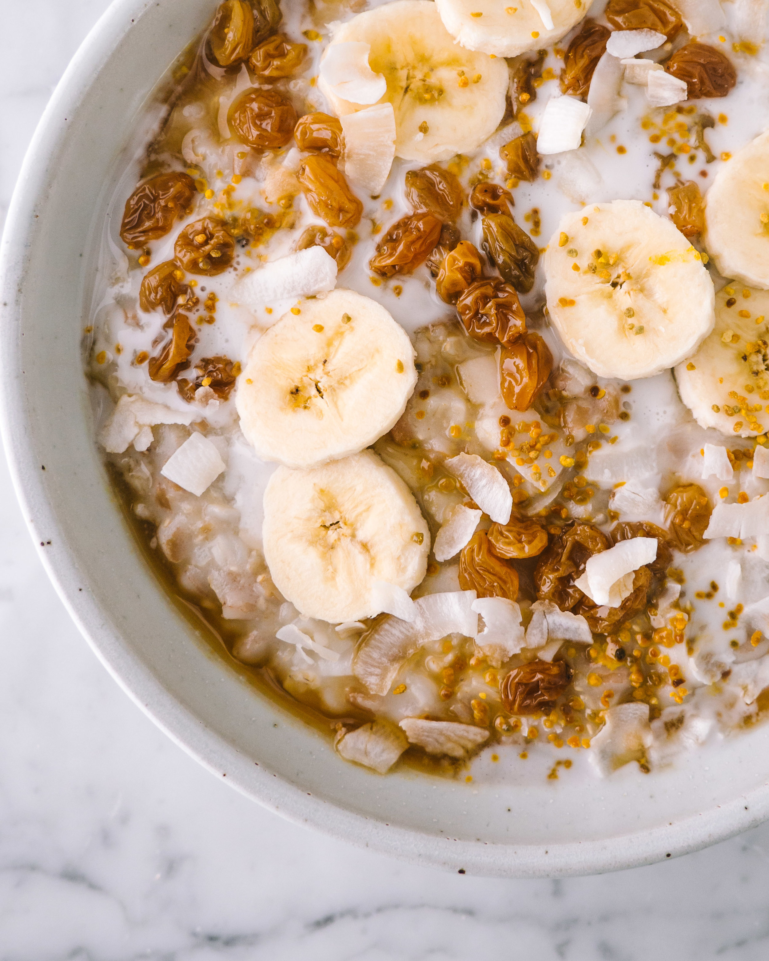 multi grain porridge with coconut and poached raisins