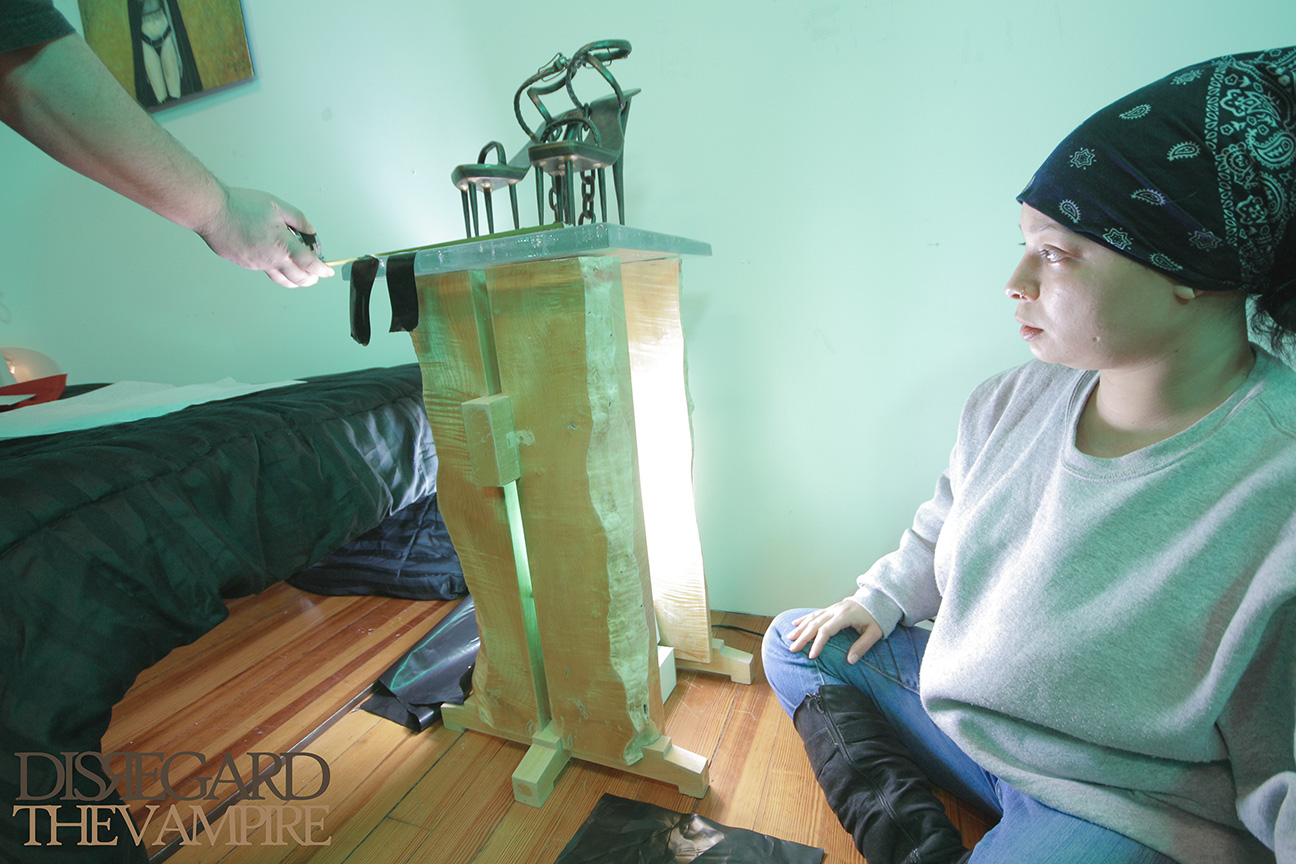 "Set designer Shevon Young lights ""The Green Room,"" 2014."