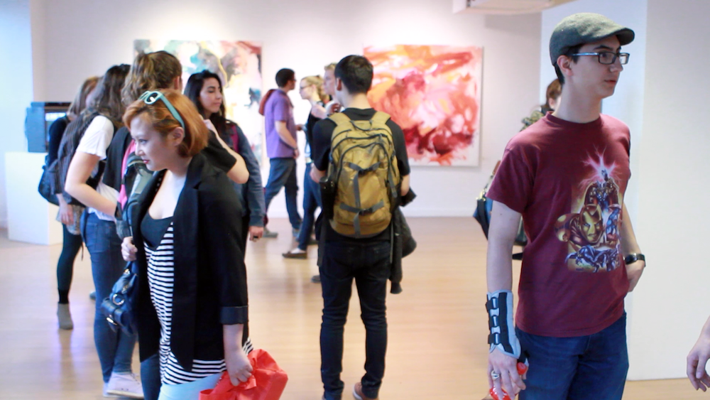 Show attendees at Geena Matuson's (@geenamatuson) TransFIREmation Gallery Show & Installation in the MassArt Student Life Gallery, 2013.