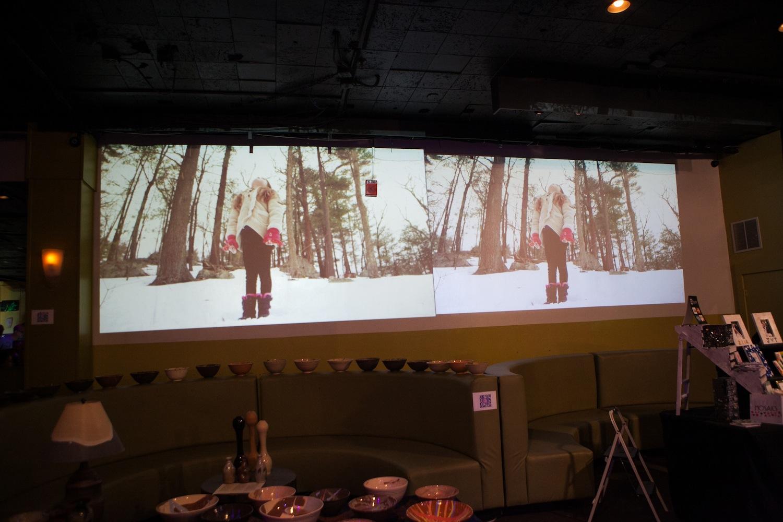 Geena Matuson's (@geenamatuson) film 'Ice Cream for Breakfast' projected on wall at RAW Artists 'Revolution' event, 2014.