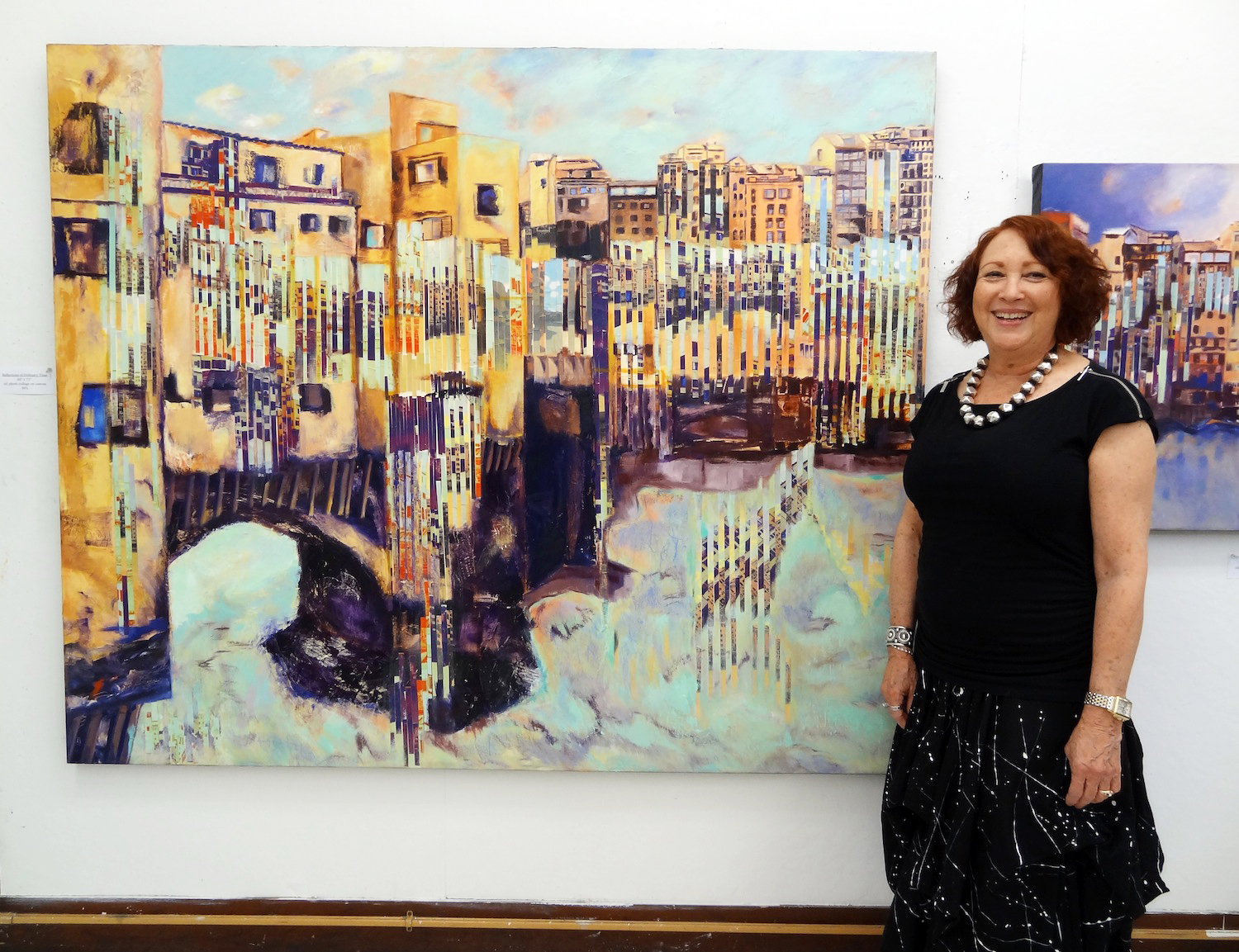 Artist Dee Cohen stands before her work, part of her 'Time In Oscillation' series, 2014.