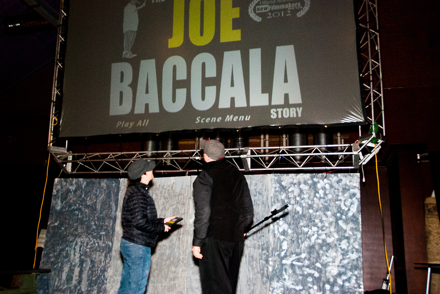 Stacey Forbes Iwanicki and Rocco Mesiti gaze at 'The Joe Baccala Story' on the big screen at Boston Indie Mafia event, March 2015. Photo by Light Filters Studio.