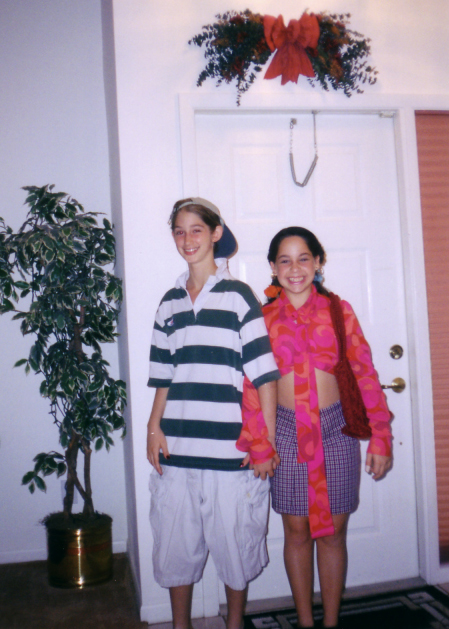 Me and a friend around age 10, dressed as a 'couple.' I'm wearing my step-brother's clothes.