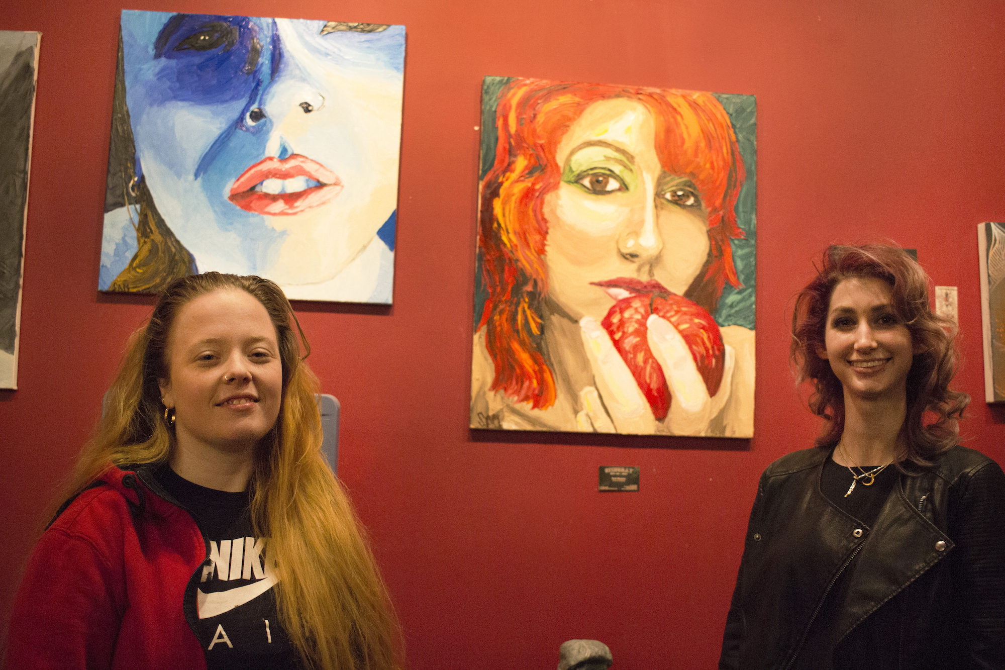 Melissa and Geena Matuson, stand before 'their paintings' by Scott Matalon at The Stingray Body Art Tattoo Artist Art Show, March 2016.
