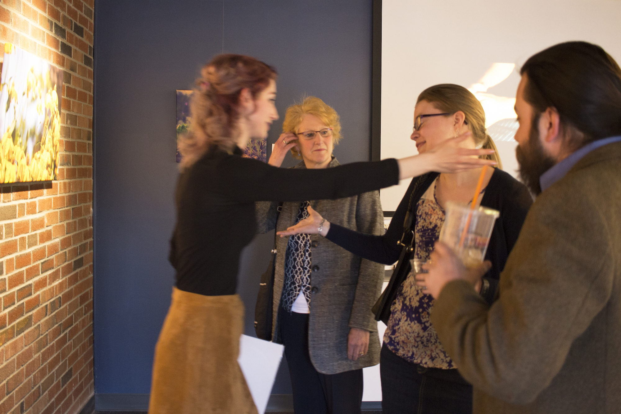 Geena Matuson's solo show reception at Medfield TV. Going in for a librarian hug! April, 2016.