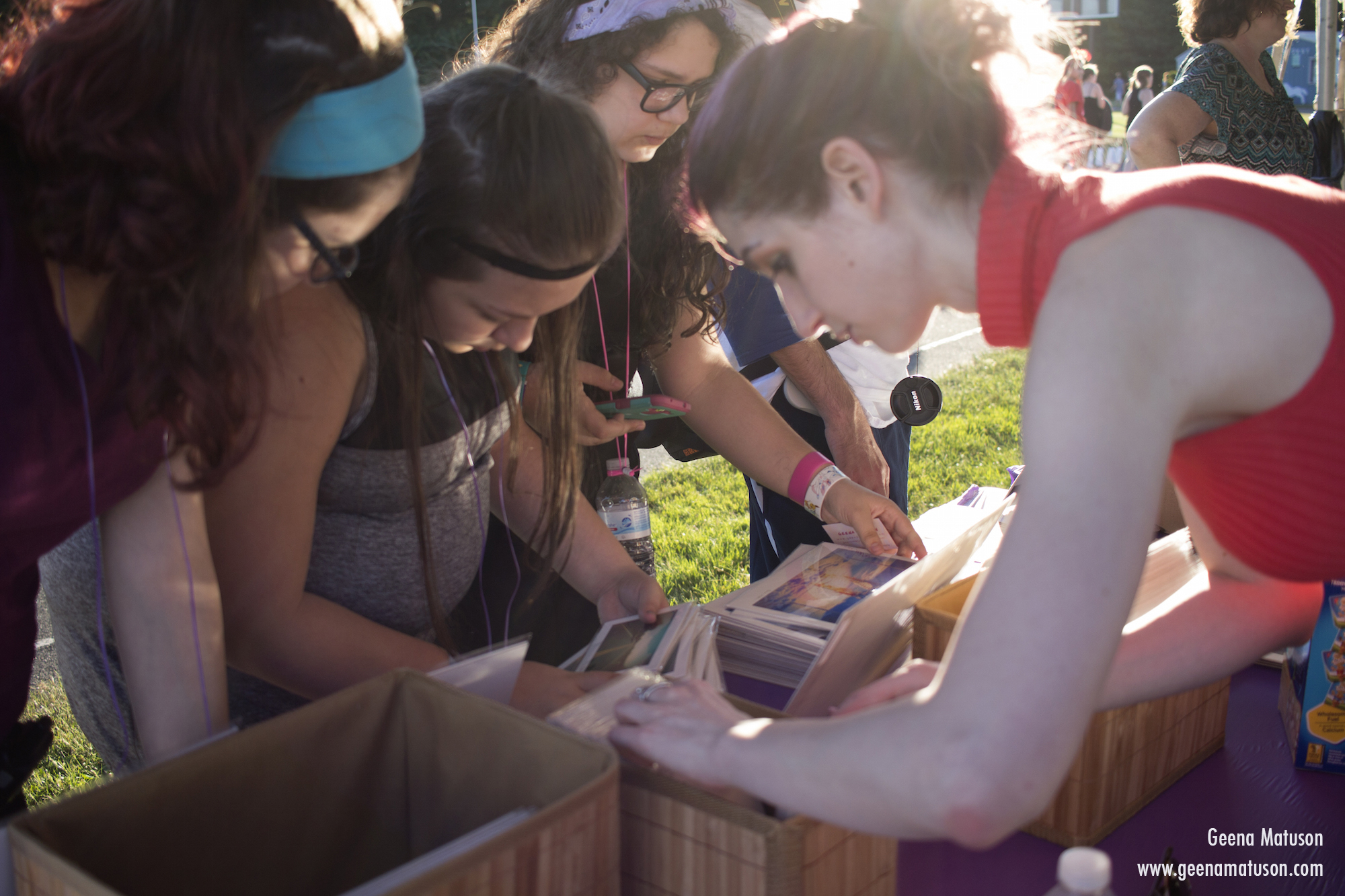 Relay walkers look at Geena's art at Relay for Life in Medway, MA 2016. Photography by Joe Musacchia.
