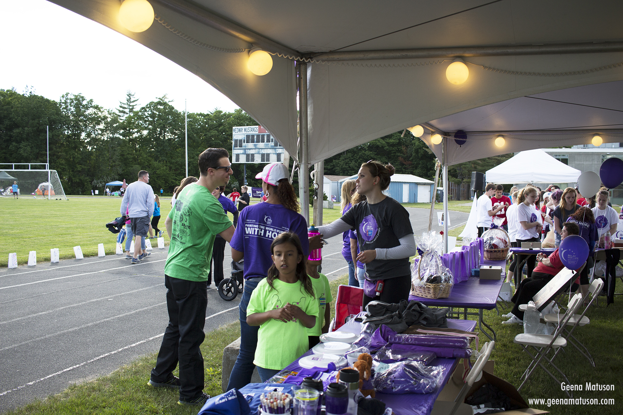 Event Coordinator Louise Fonteyne greets a participant at Relay for Life in Medway, MA 2016. Photography by Geena Matuson.