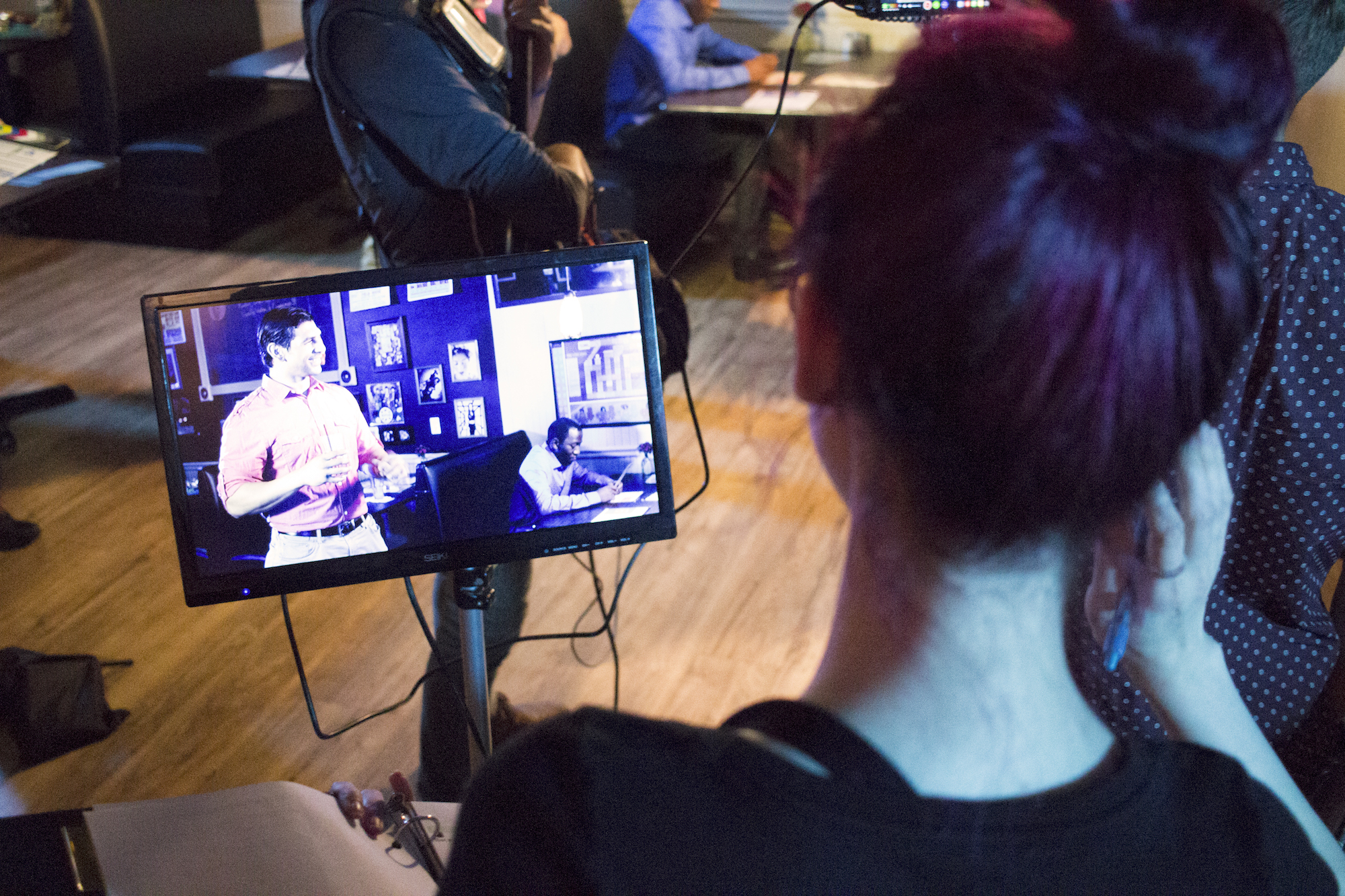 Writer, Producer/Director Geena Matuson watches performance by Casey William Hines on monitor in her production of 'Fauxmercials' bar ads, September 2016.