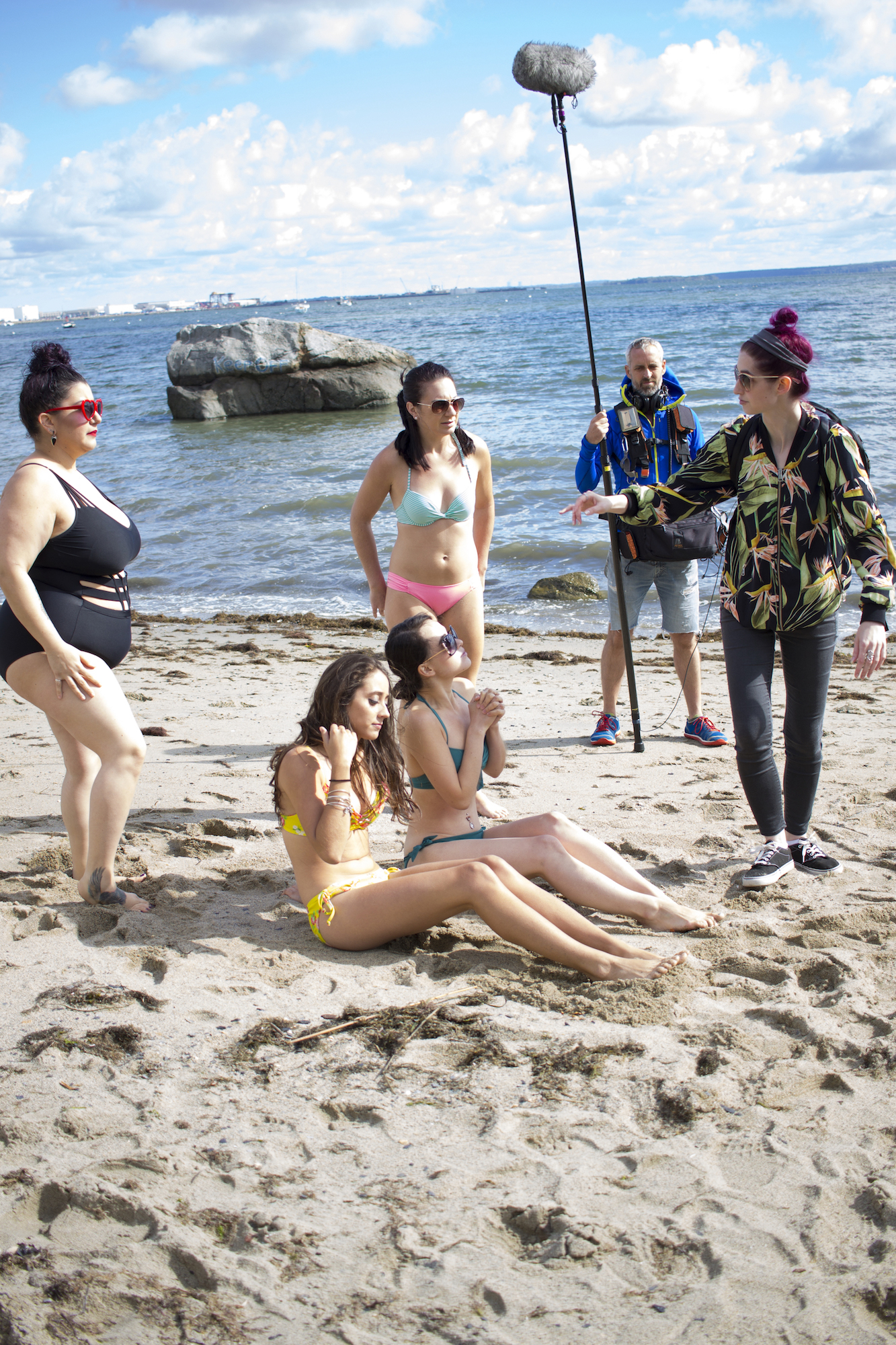 With Audio Djim Reynolds at back, Writer, Producer/Director Geena Matuson directs Actors Alessandra Grima, Catalina Snape, Acei Martin and Maya Simone on the set of Matuson's production of 'Fauxmercials' beach ads, September 2016.