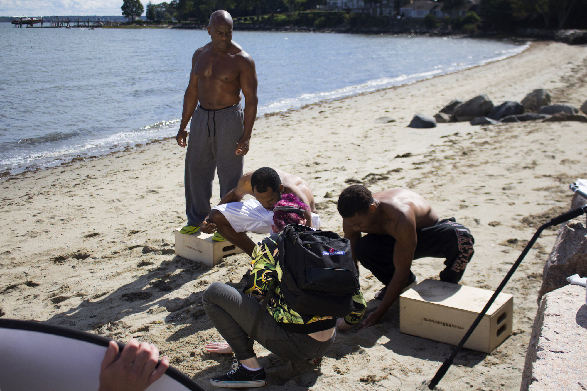 Actors Kevin O. Peterson, Reggie Joseph and Sean Brown with Writer, Director/Producer Geena Matuson as they dig a ditch on the set of Matuson's production of 'Fauxmercials' beach ads, September 2016.