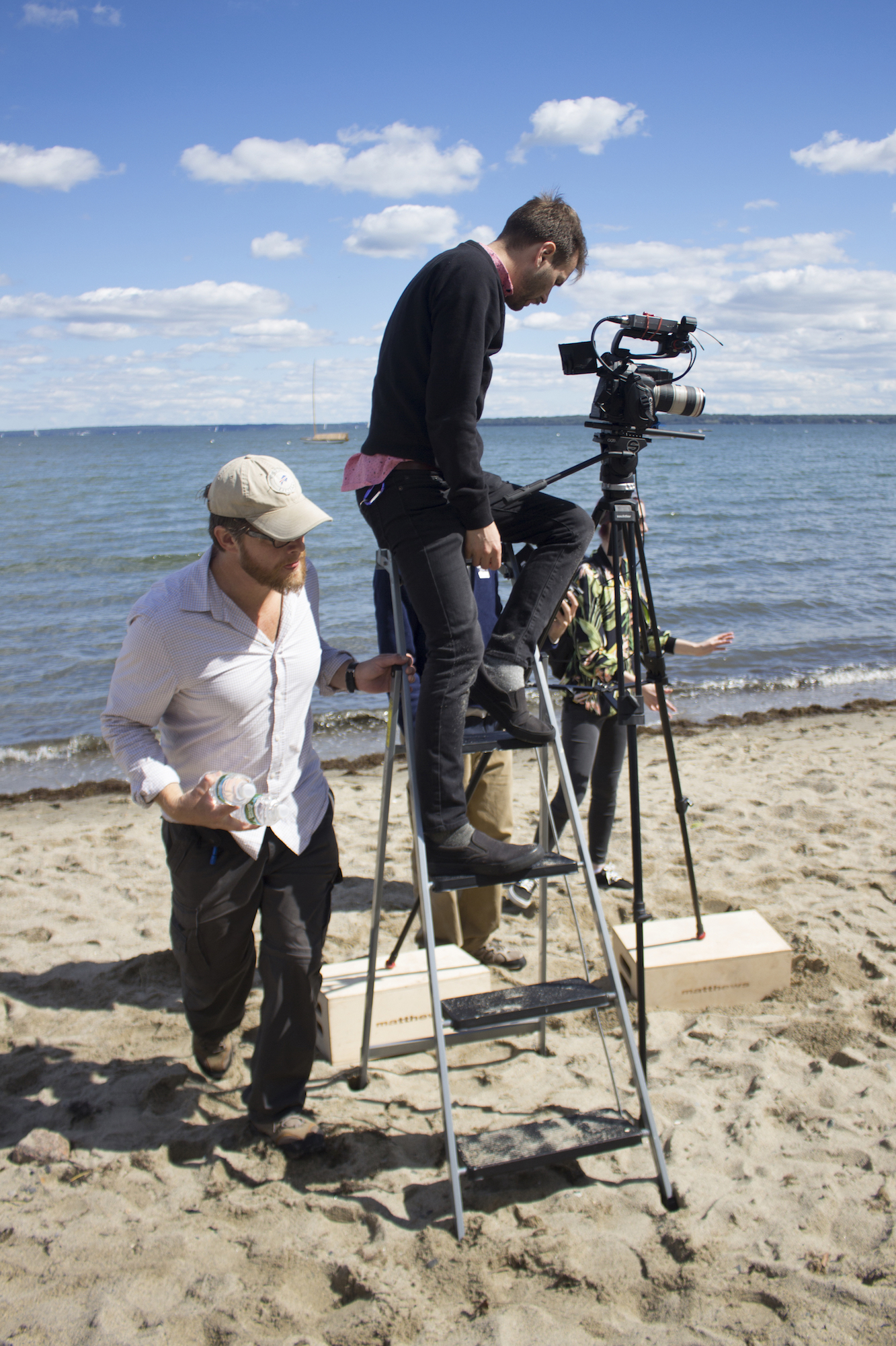 Grip/Gaffer Dan Perez de la Garza with Director of Photography Denez McAdoo on the set of Geena Matuson's production of 'Fauxmercials' beach ads, September 2016.