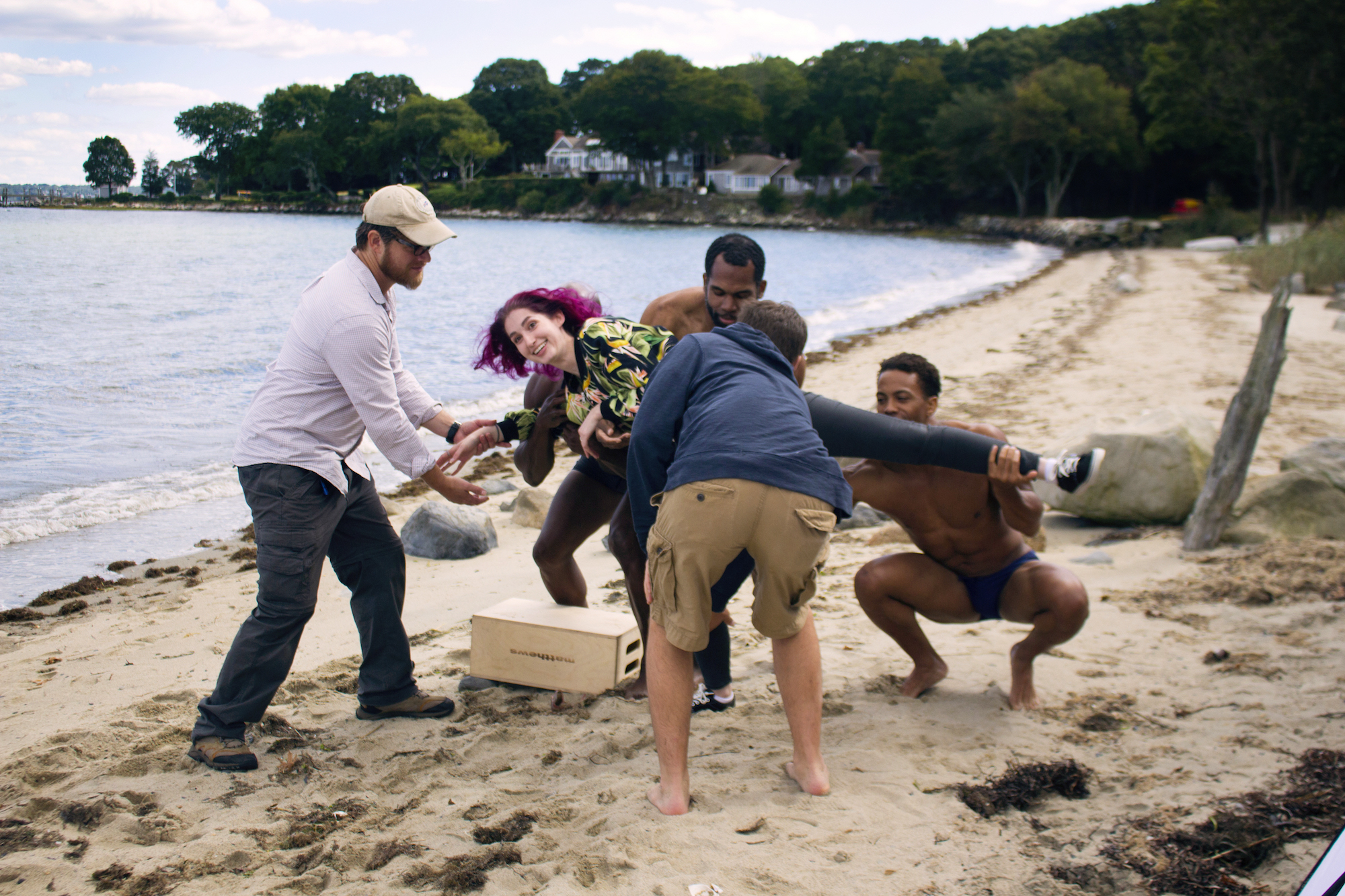 Unsure how to facilitate 'the lift,' grip/gaffer Dan Perez de la Garza helps Actors Kevin Peterson, Reggie Joseph and Sean Brown raise Geena Matuson for her new promo, on the set of her 'Fauxmercials' series filming through 2017.