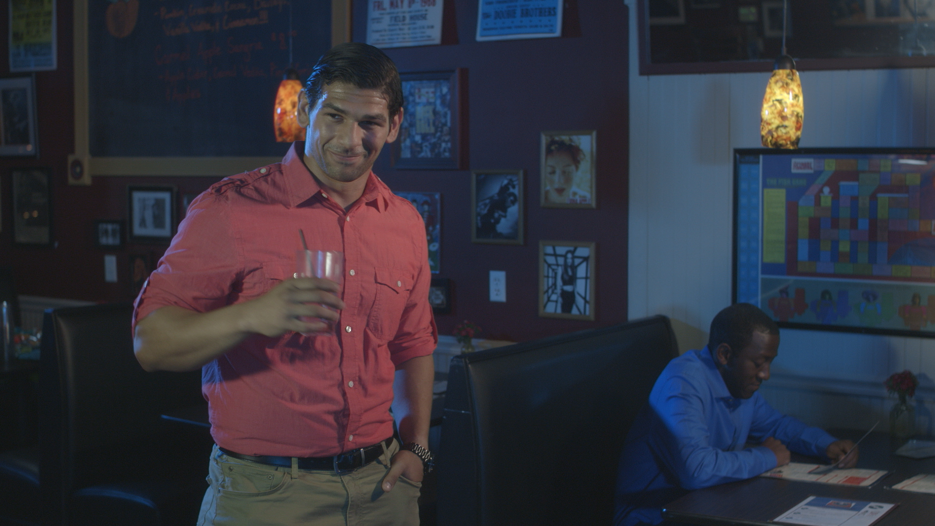 Casey William Hines with Jamaal Eversley at back in Geena Matuson's (@geenamatuson) upcoming short 'The Best A Man Can Get' filmed at Rock 'n' Roll Rib Joint in Medfield, MA. Cinematography by Denez McAdoo.