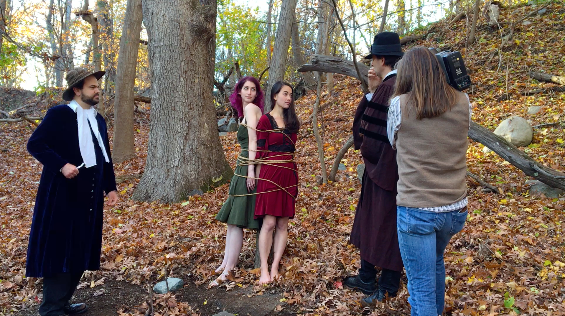 John Hartman of Reel Groovy Films on camera captures witches Geena Matuson (@geenamatuson) and Maya Simone offered their 'lost chonce' to confess, or burn. Pilgrims Dawn Nightshade and Caleb Huntington bear witness.