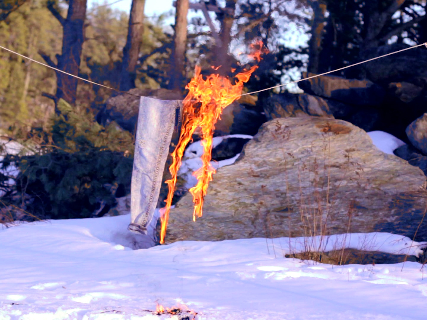 A Study In Blue Jeans - This piece involves a pair of jeans burning on a clothesline. The transformation of pants due to the fire, and transformation of fire as it destroys the pants, shows the ephemeral nature of things; no pair of pants will ever burn the same way.Múm song 'Scratched Bicycle/Smell Memory' from album 'The Peel Session' was reversed to accompany this non-looping version.