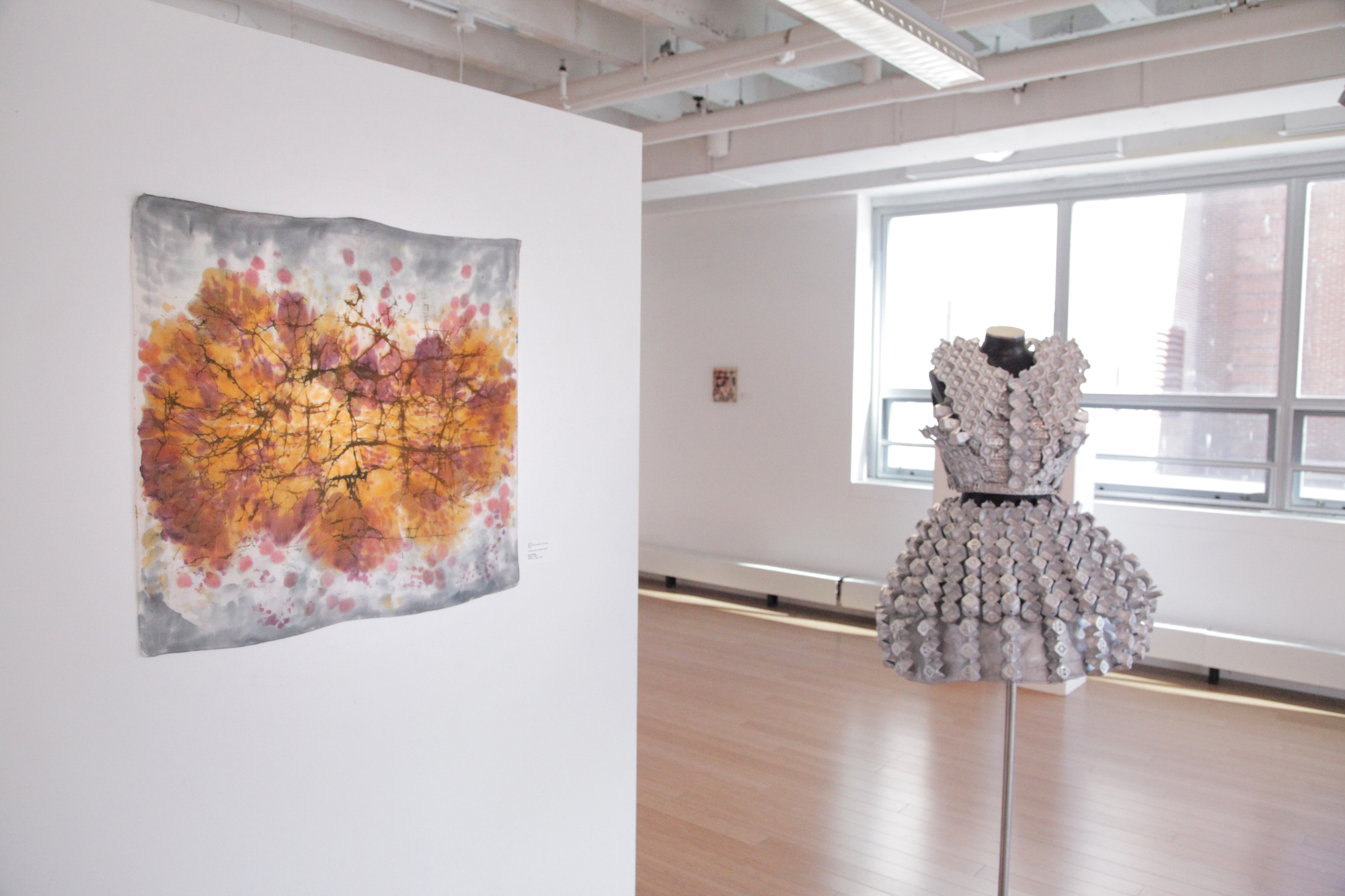 Featured Emelie Bergh work in 2D fibers and fashion industrial design. / Geena Matuson's (@geenamatuson) TransFIREmation Gallery Show & Installation in the MassArt Student Life Gallery in Boston, MA, US.