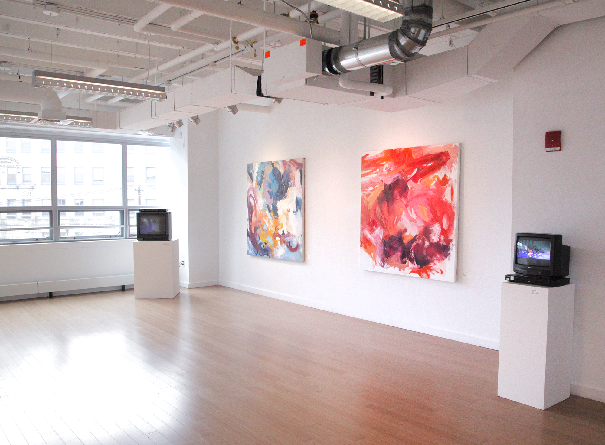Featured Carly Sheehan paintings and TVs displaying Pat O'Neil video art. / Geena Matuson's (@geenamatuson) TransFIREmation Gallery Show & Installation in the MassArt Student Life Gallery in Boston, MA, US.