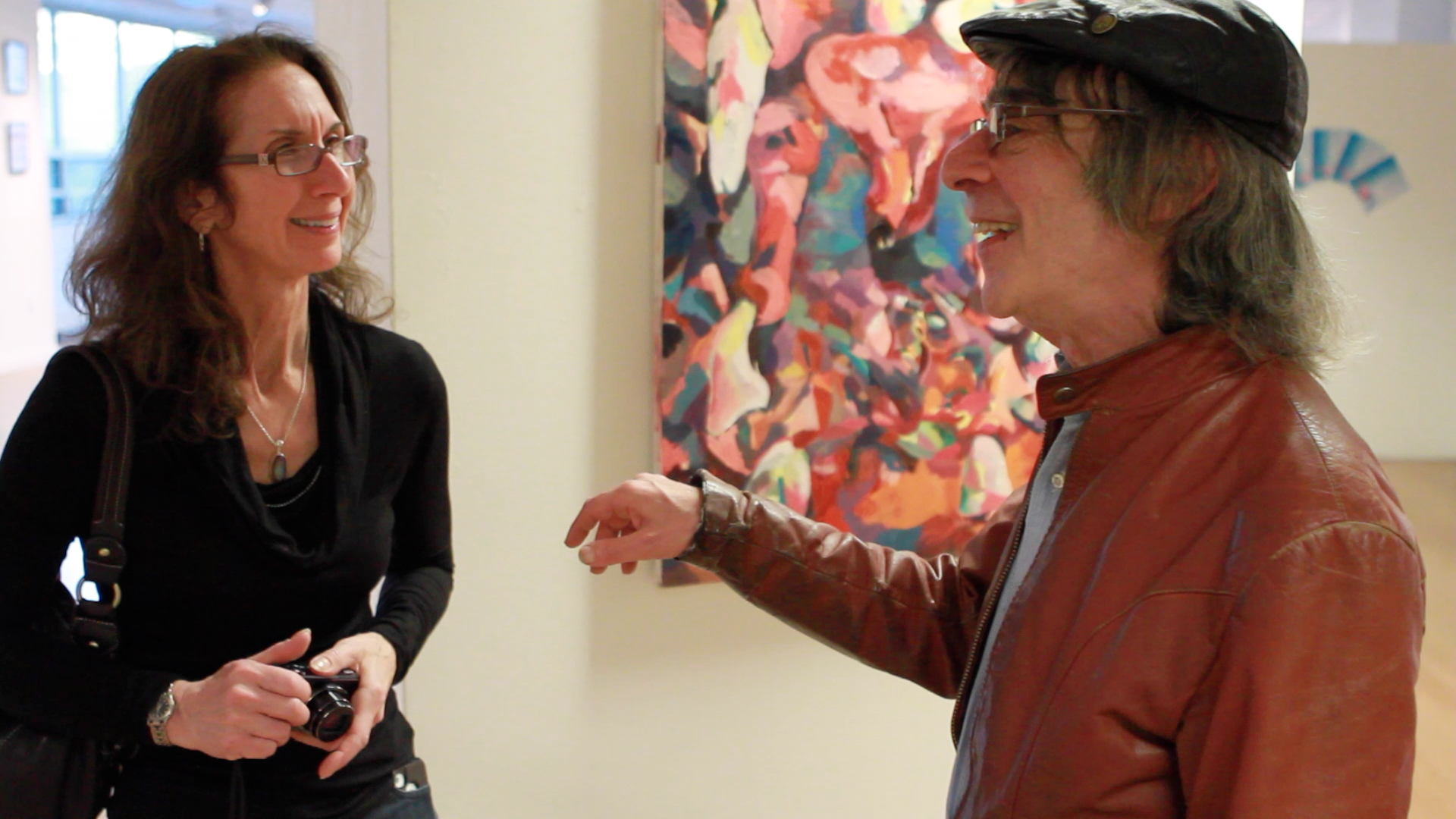 Leah Matuson talking with MassArt Film/Video Professor Saul Levine at Geena Matuson's (@geenamatuson) TransFIREmation Gallery Show & Installation in the MassArt Student Life Gallery, 2013.