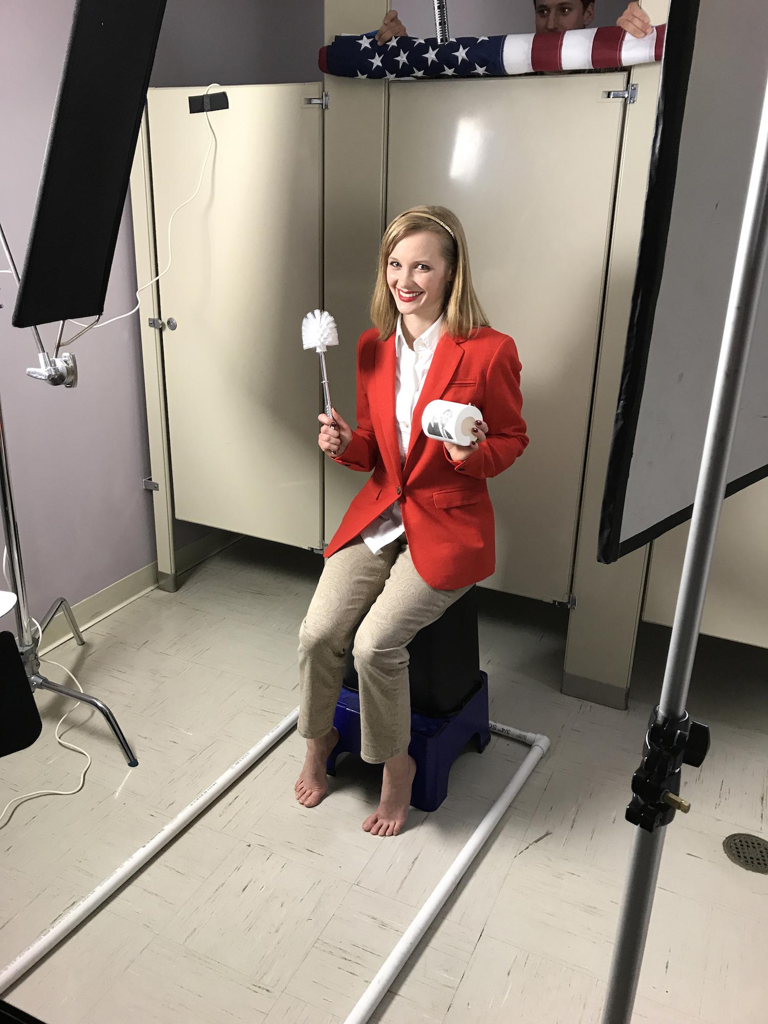 Helena Morris (and Andrew Frechette, peeking out) behind the scenes on Geena Matuson's (@geenamatuson) video 'Dump Trump,' part of her #Fauxmercials series in 2017. See more @ thegirlmirage.com.