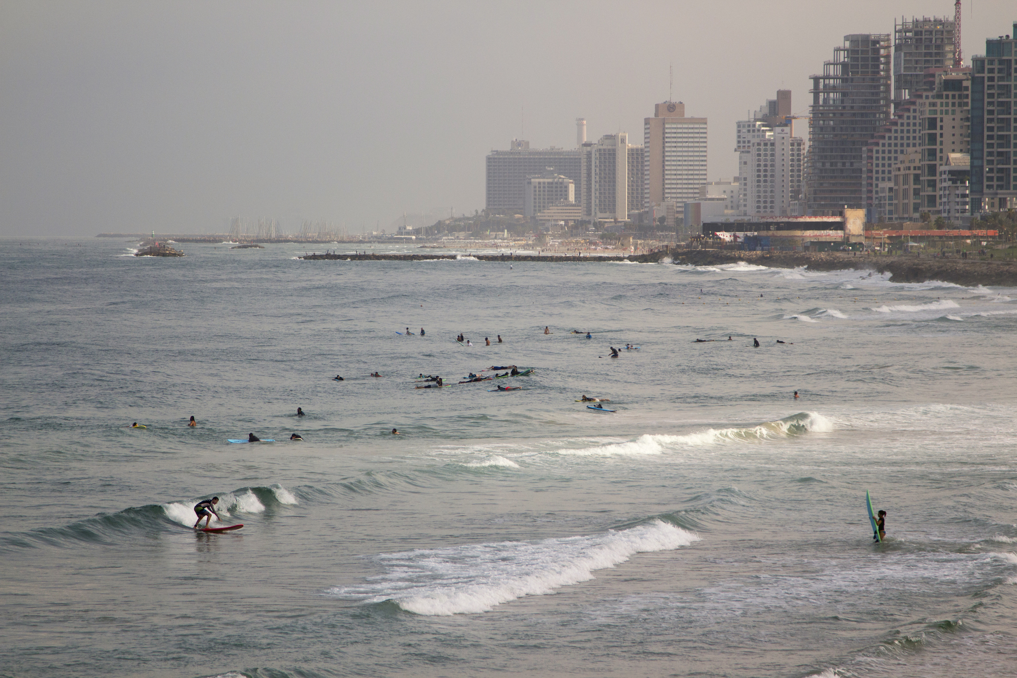 Early morning surf in Tel Aviv, Israel. See more #travel photography by Geena Matuson @geenamatuson #thegirlmirage at thegirlmirage.com.