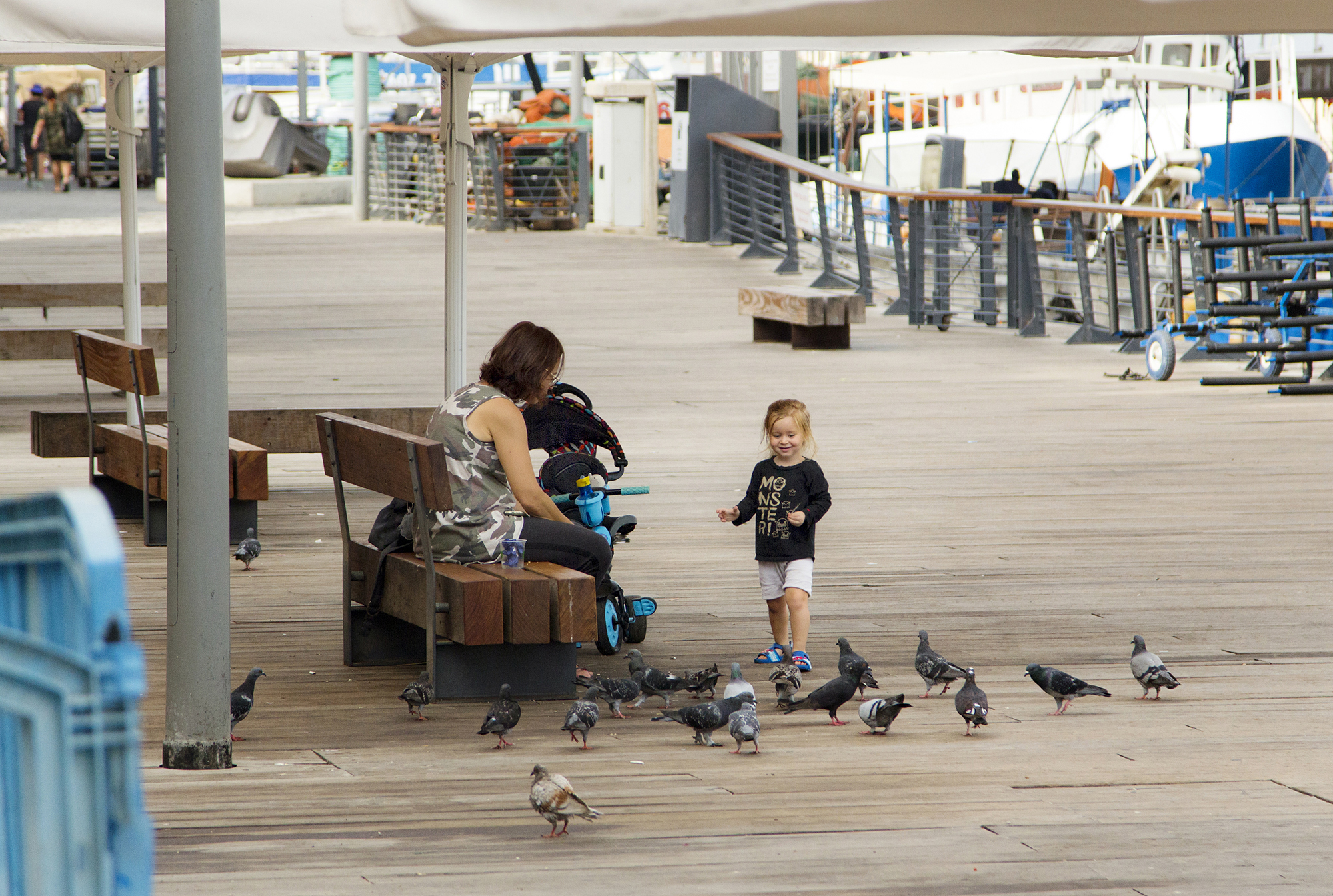A child playing with the birds in Tel Aviv-Yafo, Israel. See more #travel photography by Geena Matuson @geenamatuson #thegirlmirage at thegirlmirage.com.
