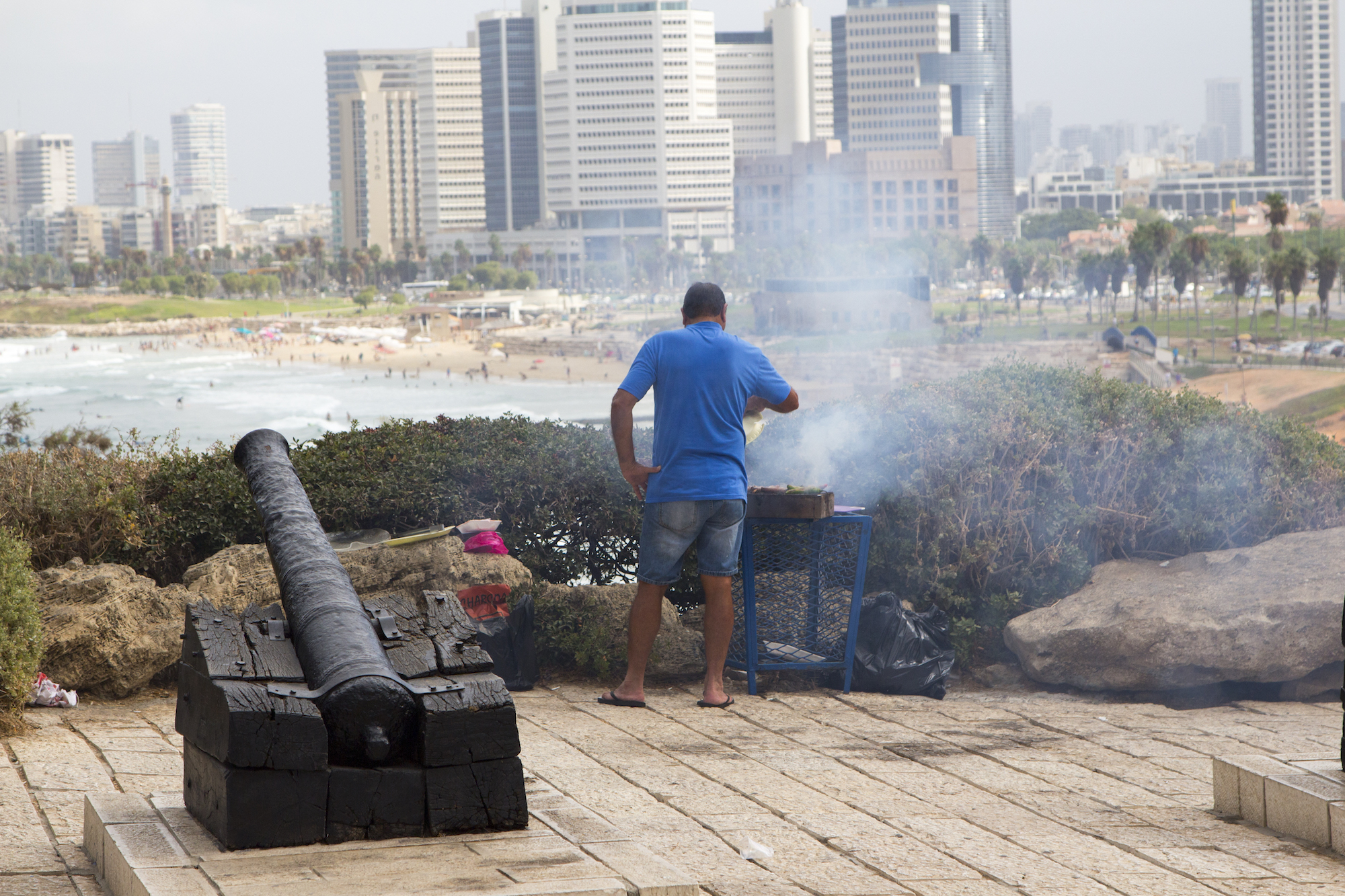 Always a good day for a garbage can BBQ in Tel Aviv-Yafo, Israel #travel photography by Geena Matuson @geenamatuson #thegirlmirage at thegirlmirage.com.