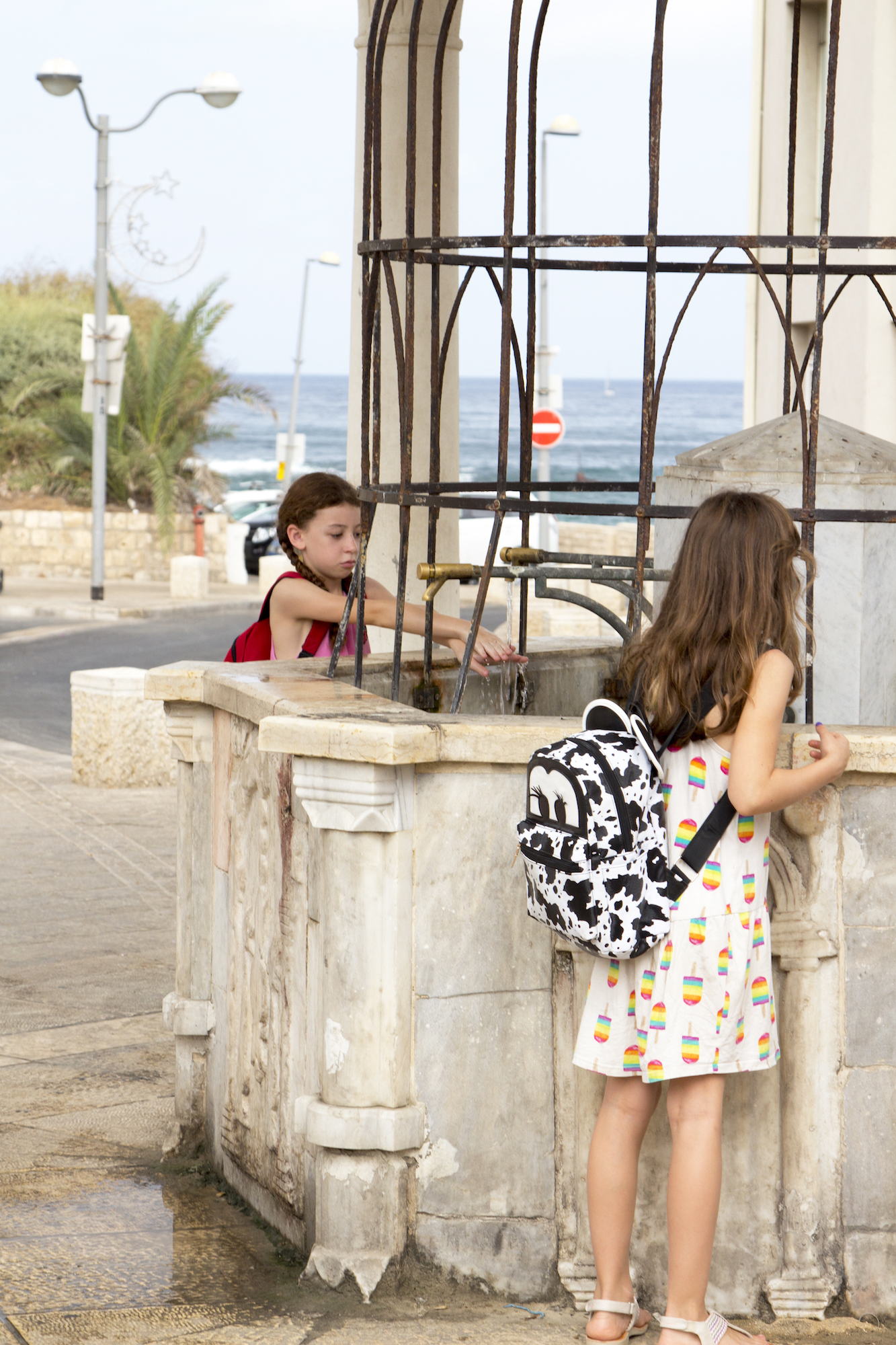 Children at a well in Tel Aviv-Yafo, Israel #travel photography by Geena Matuson @geenamatuson #thegirlmirage at thegirlmirage.com.
