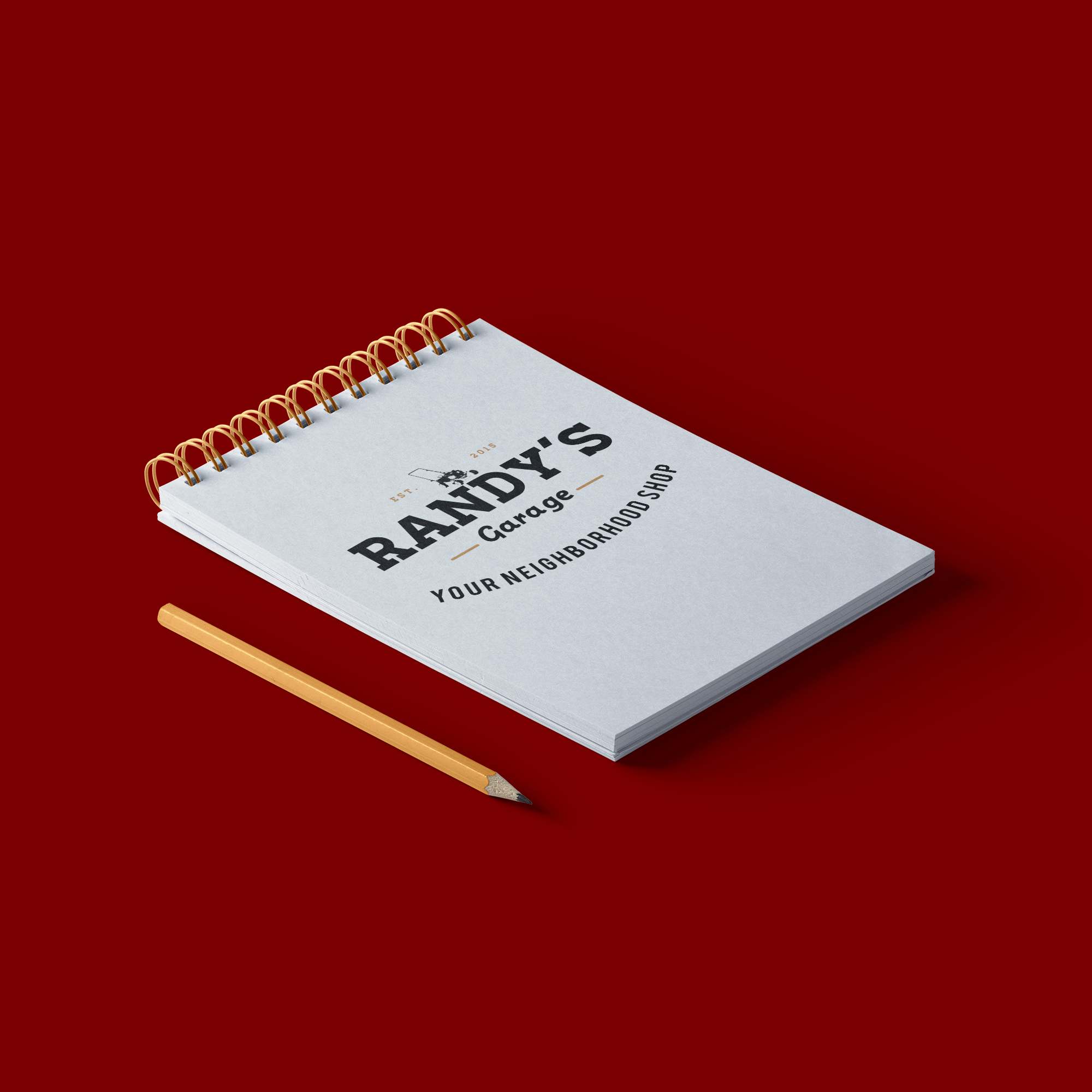 Notebook Mockup of Randy's Garage logo design by Geena Matuson @geenamatuson #thegirlmirage