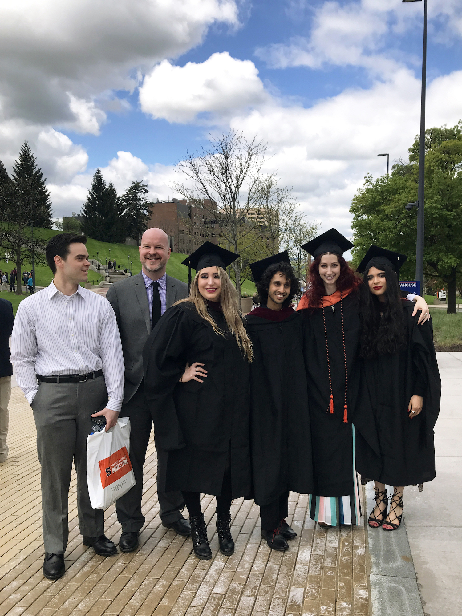 Syracuse University Masters student Geena Matuson with students from Goldring Arts Journalism cohort Michael Zawisza, Mary Walrath, Lyle Michael and Christina Nagel, with Director Eric Grode, on graduation day, May 2019.