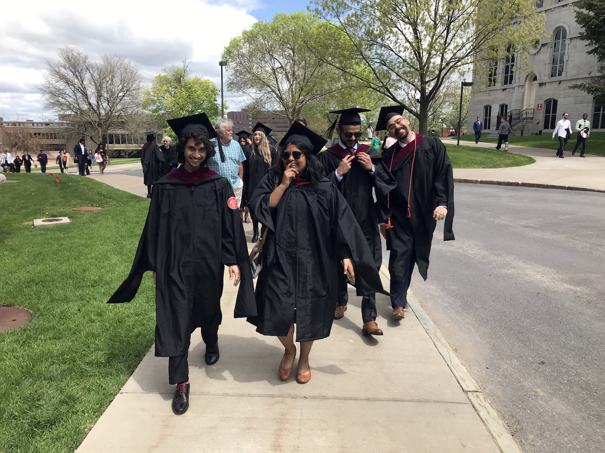 Syracuse University Newhouse Masters students Lyle Michael, Sajida Ayyup, Mo Nomani and Tyler Lowell on graduation day, May 2019.