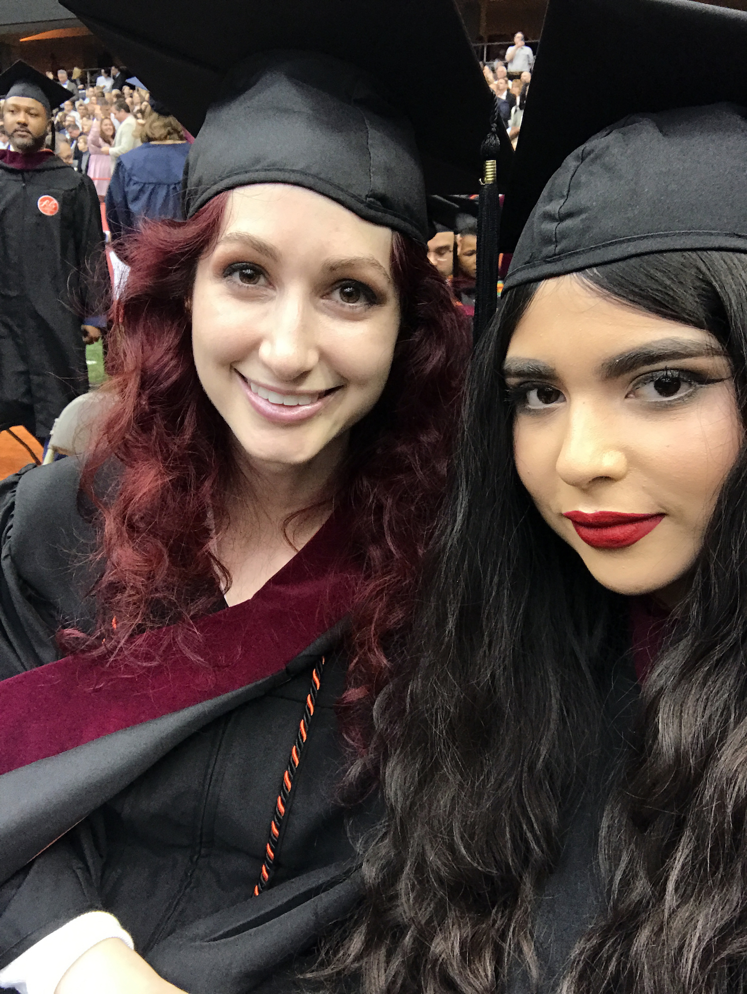 Geena Matuson with fellow Syracuse University Newhouse Masters student Christina Nagel on graduation day, May 2019.