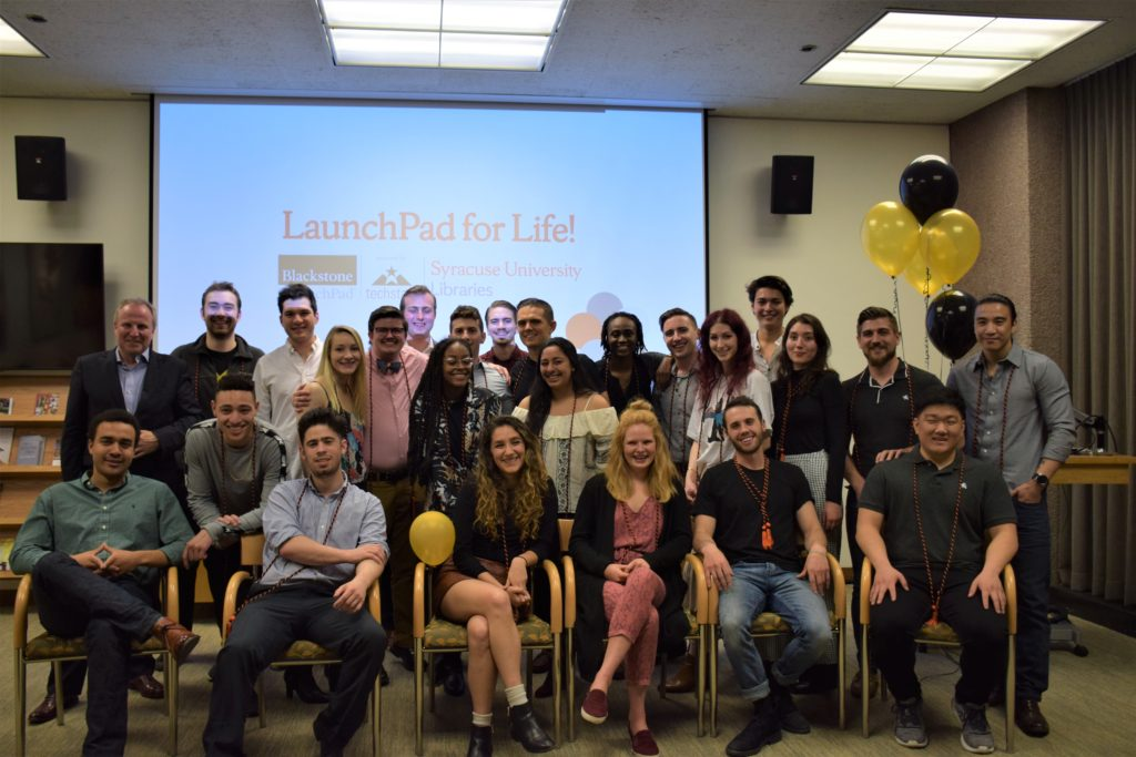 Select graduating student entrepreneurs from Syracuse University's Blackstone Launchpad powered by Techstars after being inducted into the Founders Circle, with Dean of Libraries David Seaman. Held at the Dean's Dinner held at the SU Bird Library, May 2019.