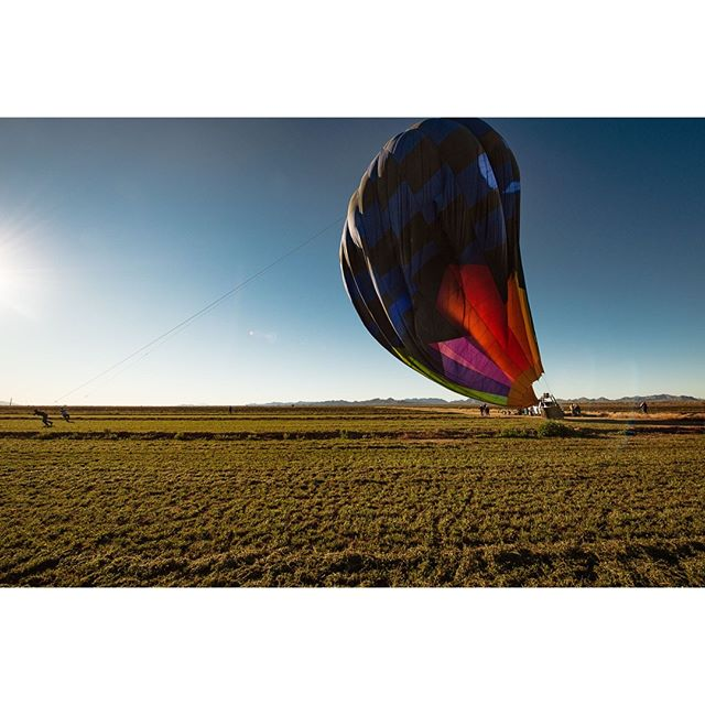 It was a bit of a bumpy landing. I thought the basket was going to tilted side ways. I was thrilled to be back on the ground. While the rest of my fellow passengers enjoyed their wine and pastry, I decided to watch as the balloon was deflated. By watch I mean run around trying to get the best angle. I just loved how the sun illuminated the balloon as it was going down.