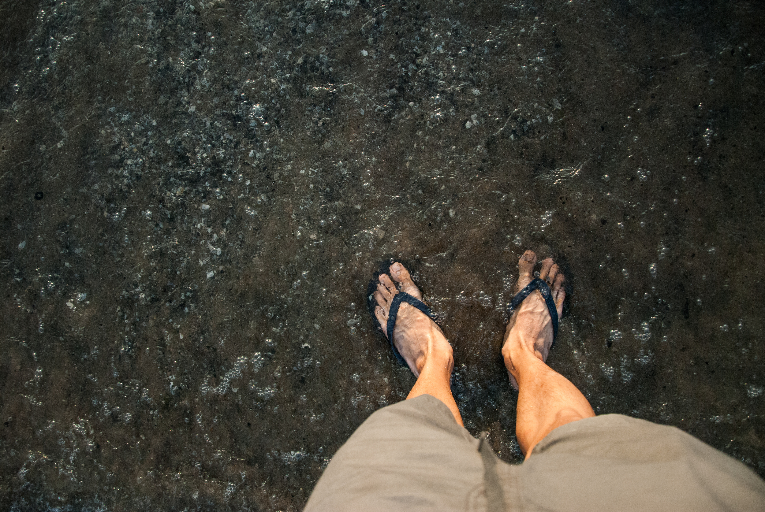Standing in Lake Erie wearing the flip flops I use for gym showers.