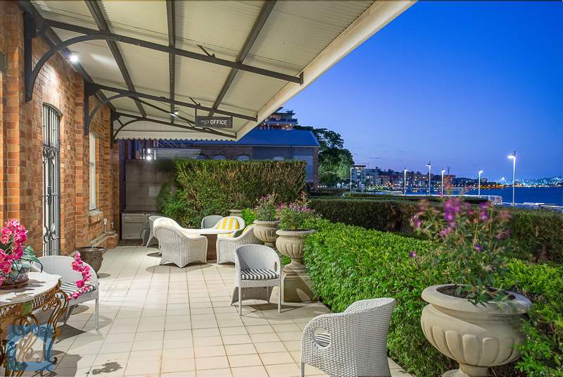 The lovely patio of this refinery property is on the doorstep of the river's boardwalk.