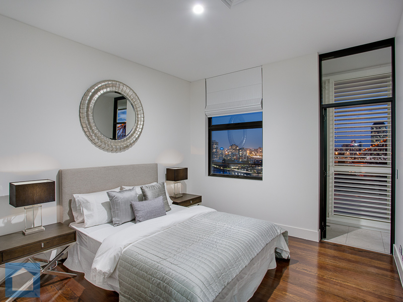 This spacious bedroom boasted a walk-in robe, ensuite and access to the fabulous balcony.