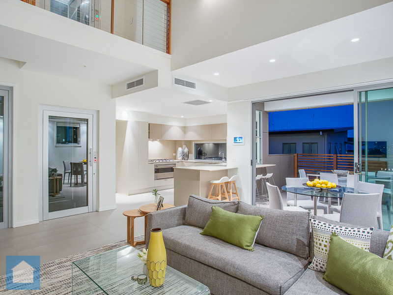 Landing overlooks this fresh and light, modernally decorated, open plan living and kitchen area.
