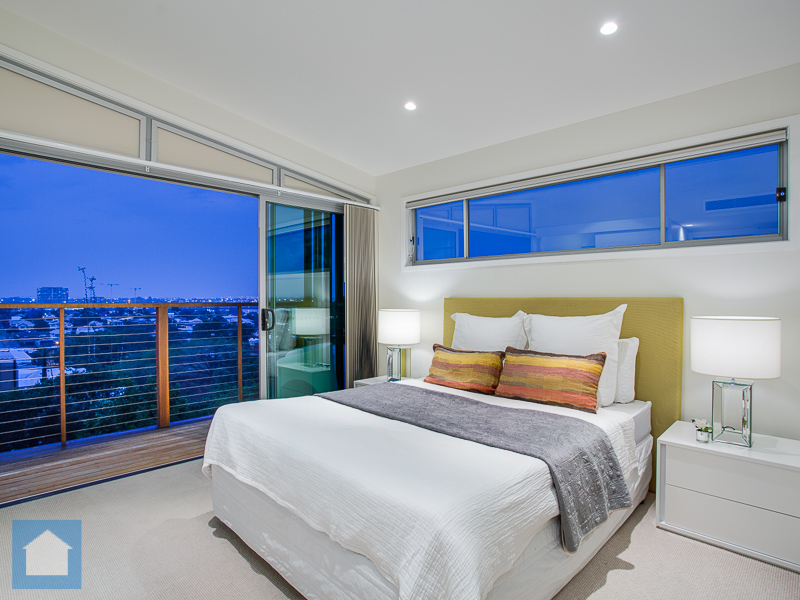 This master has style and class with stunning views of the Brisbane River and Hamilton from the bedroom balcony.