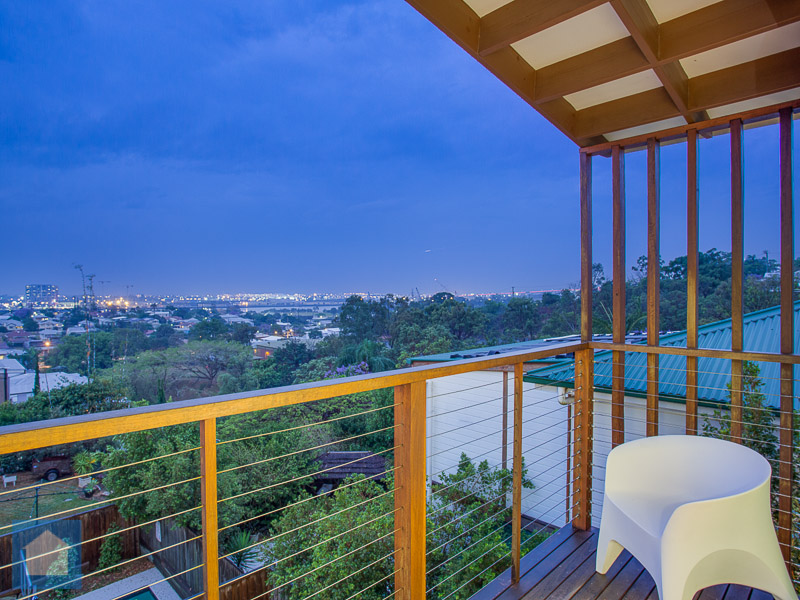 This shot shows the luscious greenery and illumination of the city lights that you can take in from the balcony.