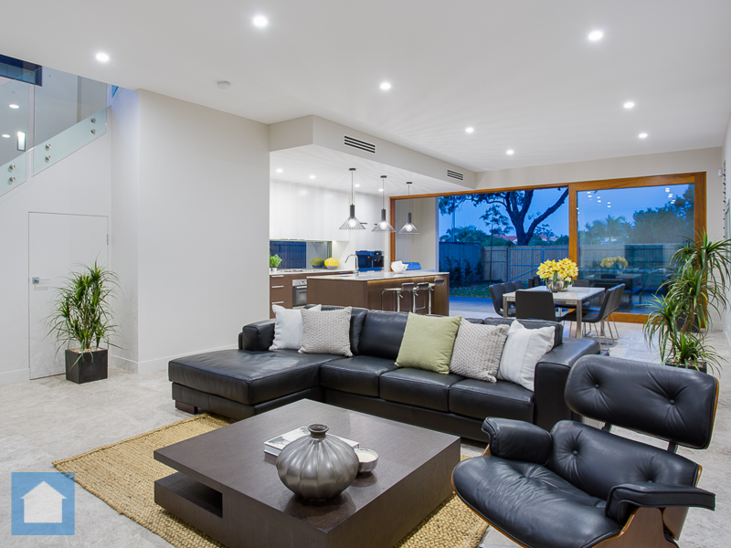 Great spacious layout with funky pendant lights in kitchen, and down lighting throughout, with crafted timber stack doors opening to the outdoor BBQ area.