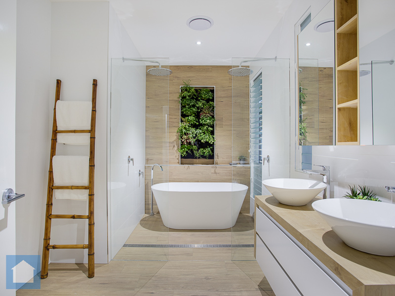 One of the nicest bathroom designs we have seen. With the great finishes and the beautiful wet area including the dual shower heads, free standing bath and the stand out green wall, this is one unique bathroom.