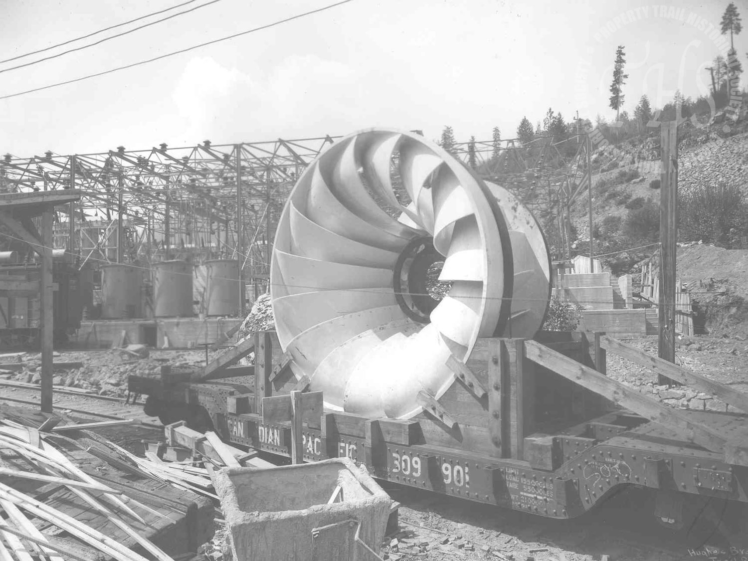 New turbine (water wheel) for Lower Bonnington Powerhouse on train bed (Hughes) - 1925