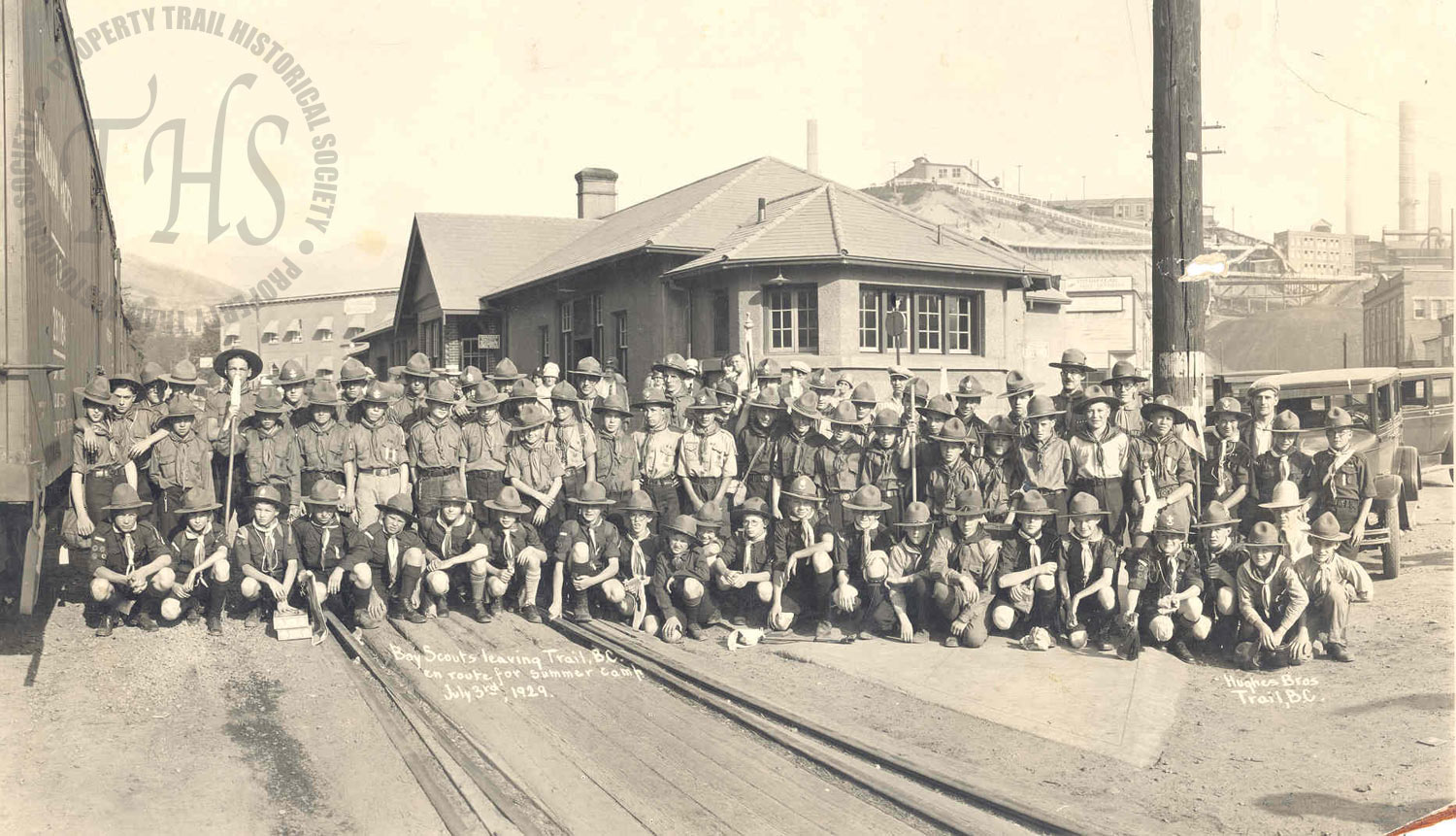 Boy Scouts, heading to Nelson for camp, train station, downtown Trail (Hughes) - 1929