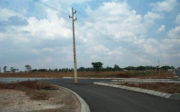 Road sign in middle of road.jpg