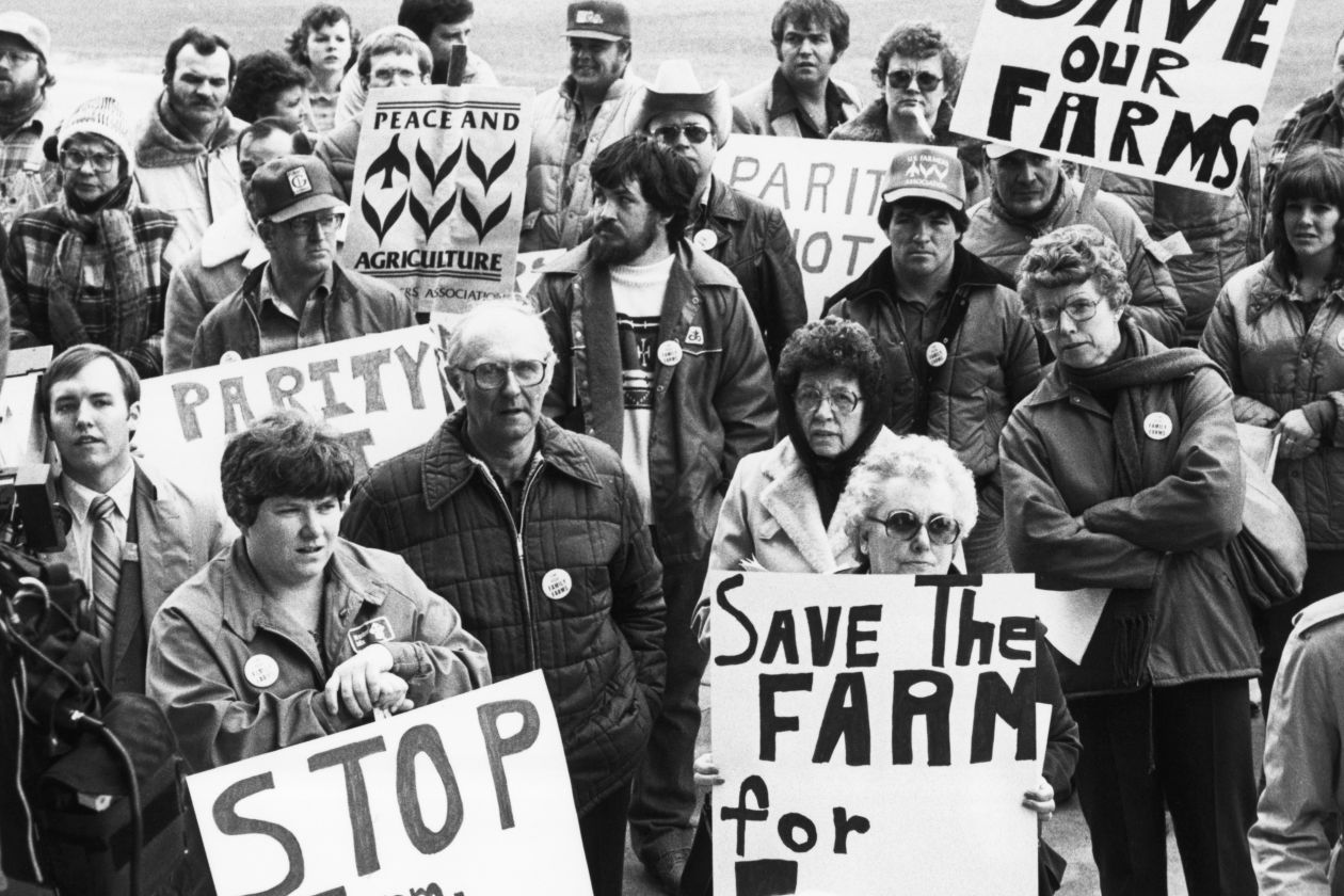 Farmers and supporters rally in 1983 in Iowa, seeking price supports for crops and a moratorium on farm foreclosures. PHOTO: BETTMANN ARCHIVE