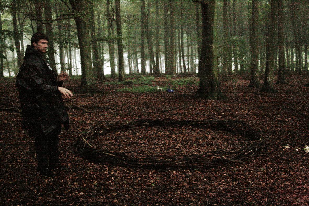 Image enhanced nightshot of a circle of sticks.