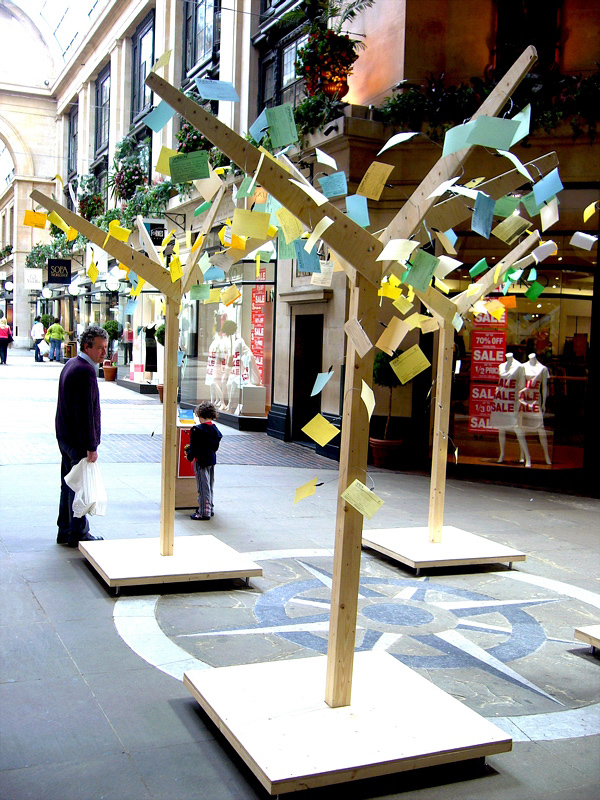 As the exhibition goes on, the trees grow into large colourful objects, creating an intriguing and engaging platform for public expression
