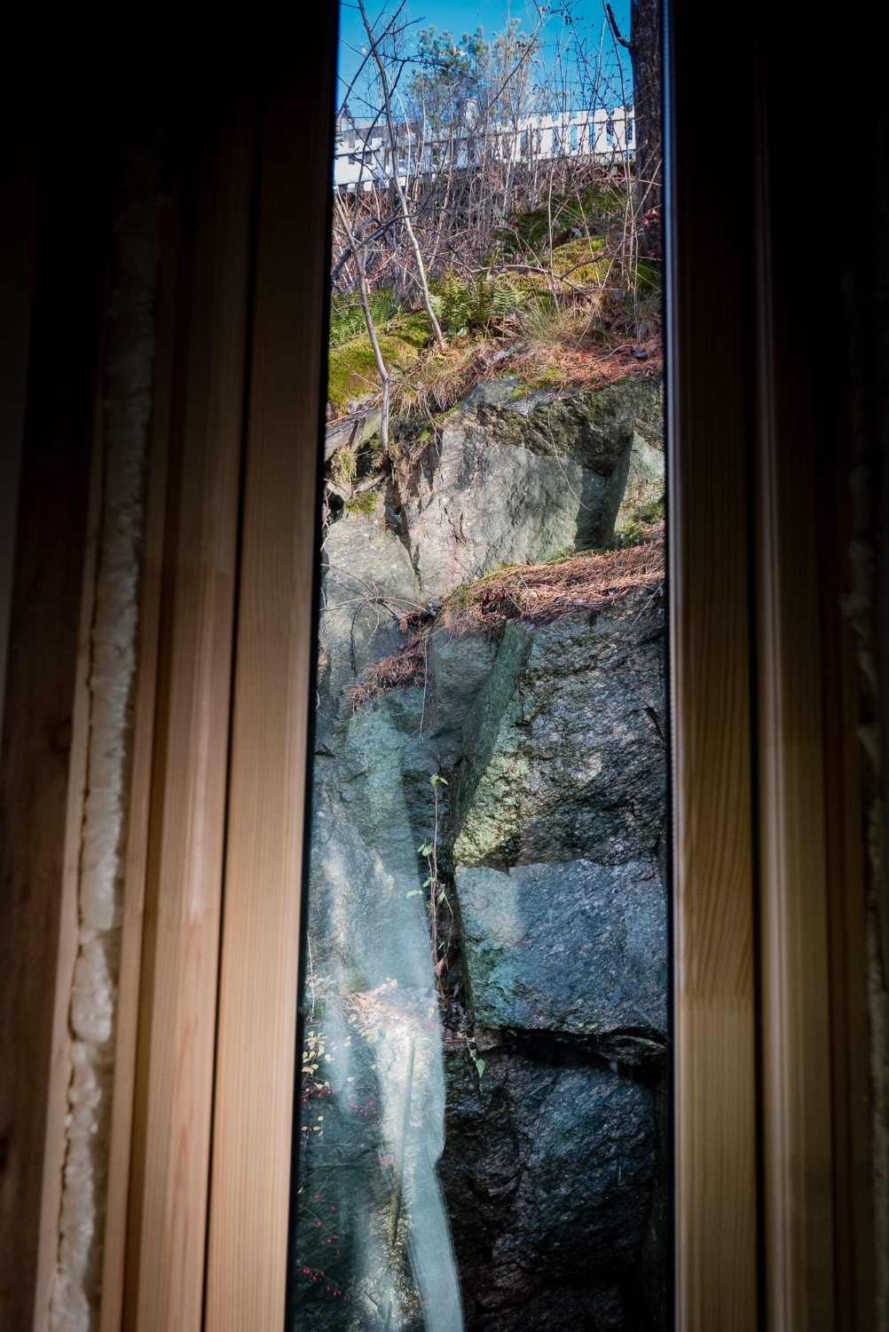 The autumn sun dappling on the rock cliff, behind the new master bedroom.
