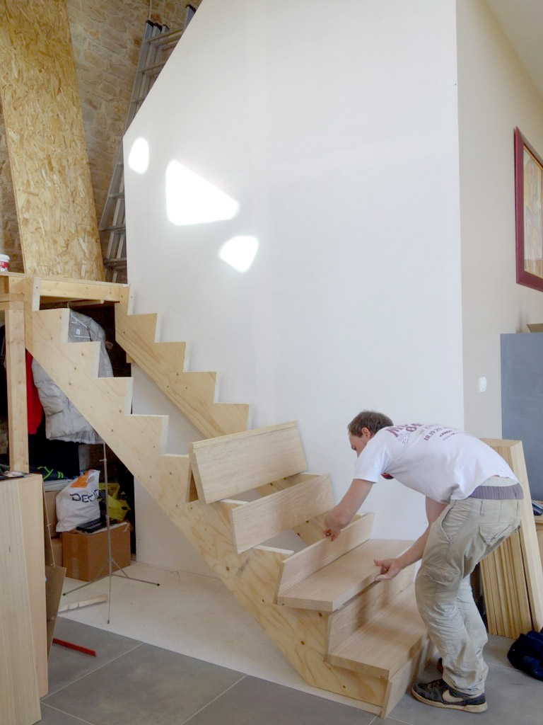 Our client building the new staircase of the converted barn, using massive oak boards sourced from a local sawmill.